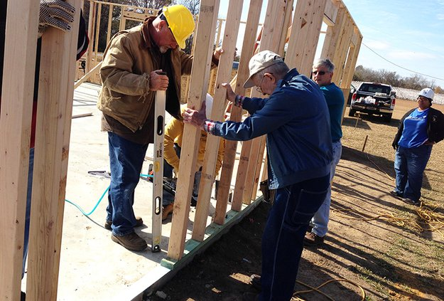 Photo courtesy Habitat for Humanity Volunteers are shown working on Habitat for Humanity of Bulloch Countys 48th house back in 2015. In the file photo are, left to right, construction manager Bill Kroutwald and volunteers Allan Webb and Jim Christy. At ri
