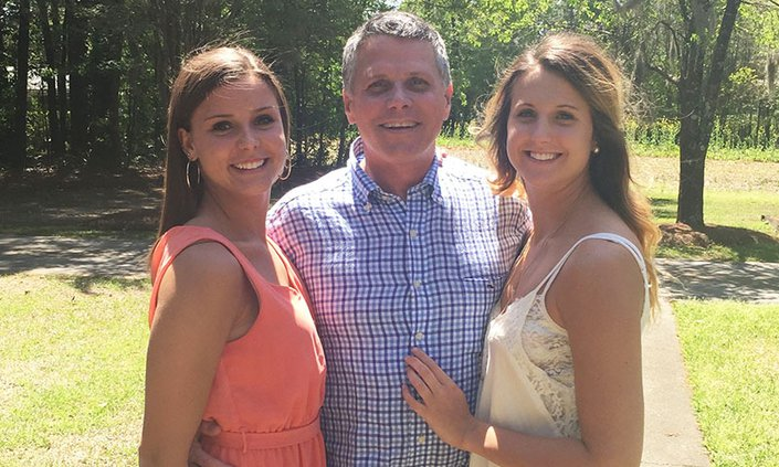 Courtesy of Abbie DeLoach Foundation Abbie DeLoach, right, enjoys a family moment with her sister Anna, left, and their father, Jimmy DeLoach Jr., sometime before Abbie's untimely death in April 2015.