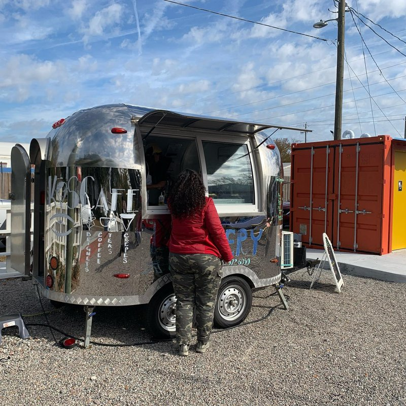 Food trucks converge at 3 Points Food Court during a December trial-opening event.