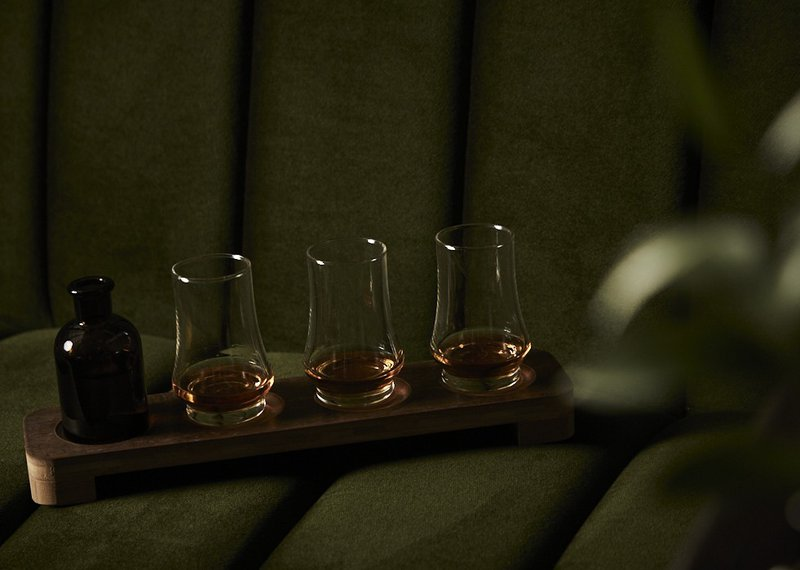 A whiskey flight served by The Trade Room.