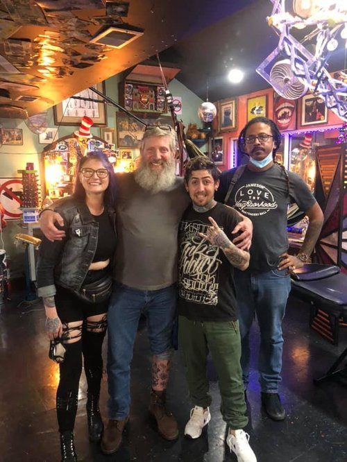 Don Caskey hangs out with the crew at Savannah's Tramp Art Studios.