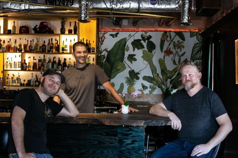 The Lone Wolfpack: Worley, Mack, and Ripley at the custom bar.