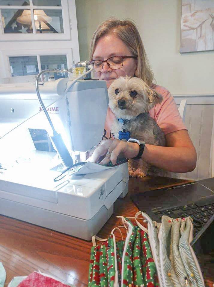 Brenda Scarpati and her dog Winston at work.