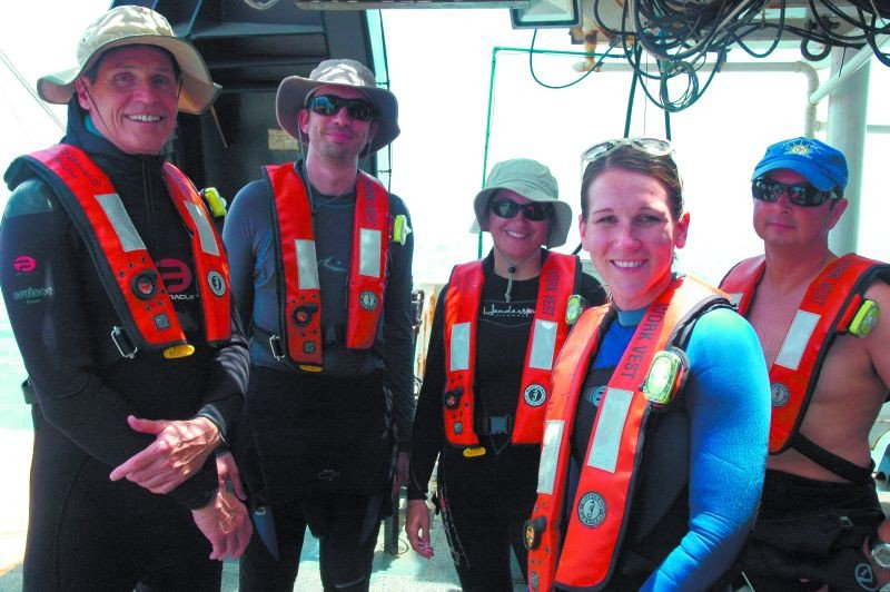Georgia Southern's Dr. Danny Gleason (l.) and other resident scientists ready for a dive