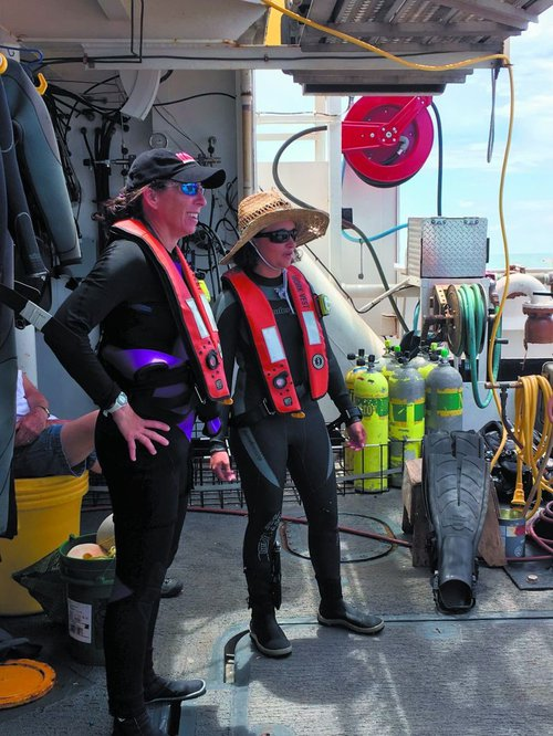 Chief scientist Kim Roberson (left) oversees operations and makes twice daily dives to collect data and specimens.