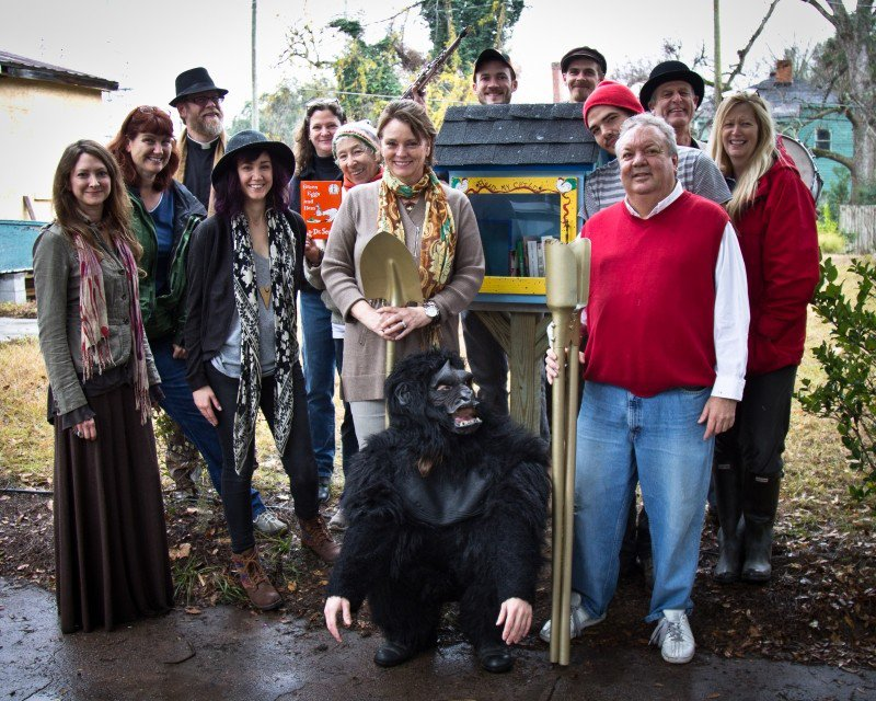 Friends of newlyweds Francis Allen and Leslie Lovell (r. and l. of the gorilla) helped dedicate the first FOC Little Free Library.