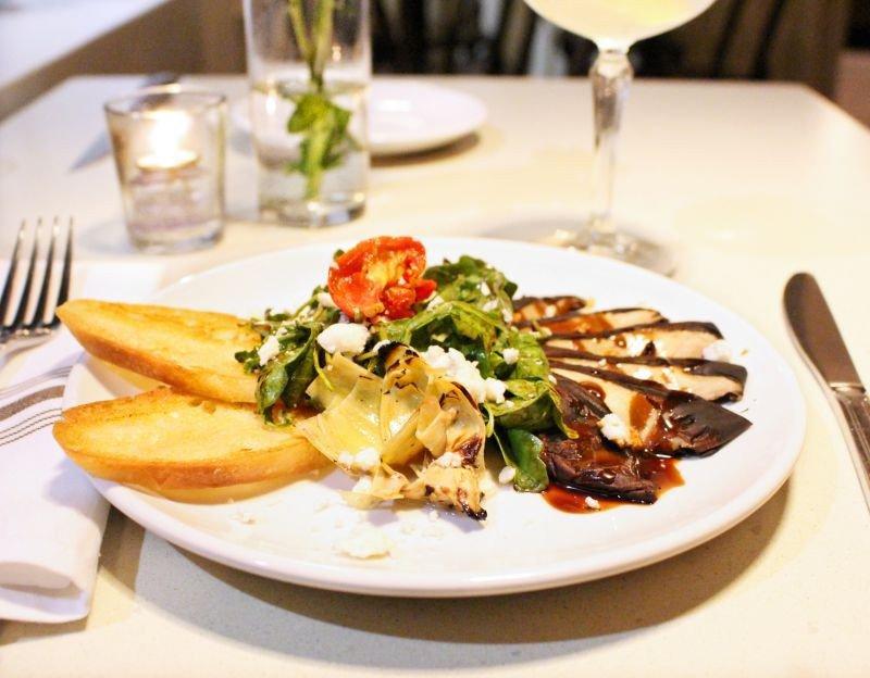 Grilled Portobello and Artichoke Salad. with arugula, roasted tomato, Bootleg Farms feta, local honey and a grilled baguette.