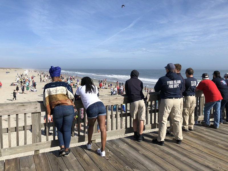 Spectators watch the New Year's Day waders from Tybee Island's pier.