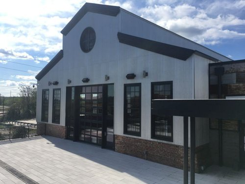 The renovated facade of the old machine shop, now a spacious meeting and event space.