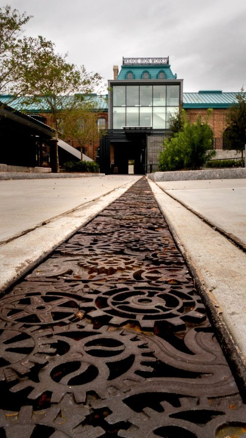 A good view of the unique 'glass tower' installation in the main building; at foreground is a stylized trench drain.