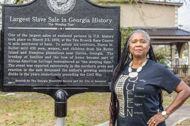 Savannah Alderwoman Bernetta Lanier stands by Savannah's historical plaque commemorating 'The Weeping Time.'