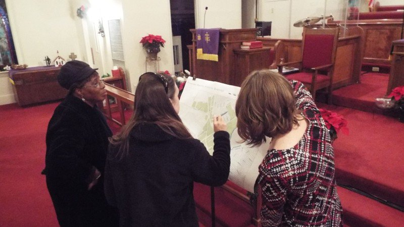 Members of the Sandfly community inspect a map of the proposed Sandfly Historic District at a community meeting at Speedwell UMC.
