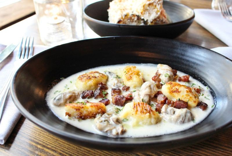 Beau Soleil oysters from New Brunswick, thick-cut house-cured bacon and homemade potato gnocchi bathe in a light vermouth cream sauce and are finished with sweet pecan oil.