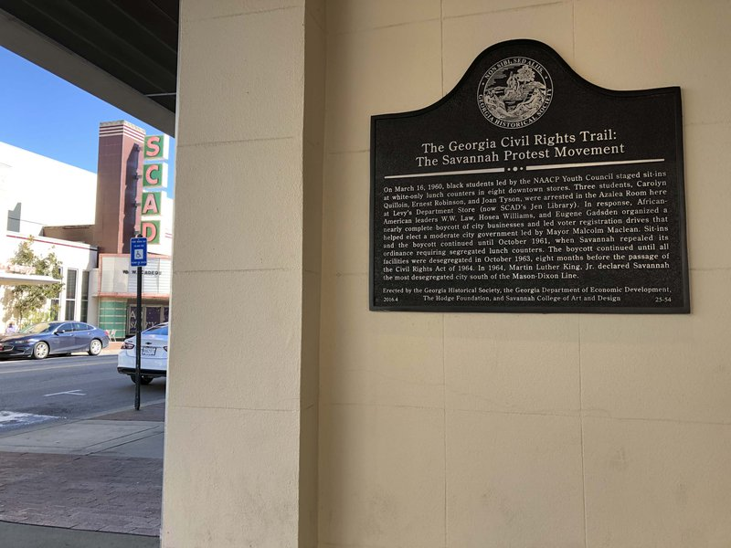 The historical plaque mounted on the former Levy's department store on Broughton Street in Savannah.