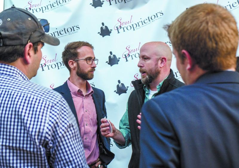 Maven Makers' Ty Donaldson (l.) brainstorms with Jim Wacker of Tytan Creates.