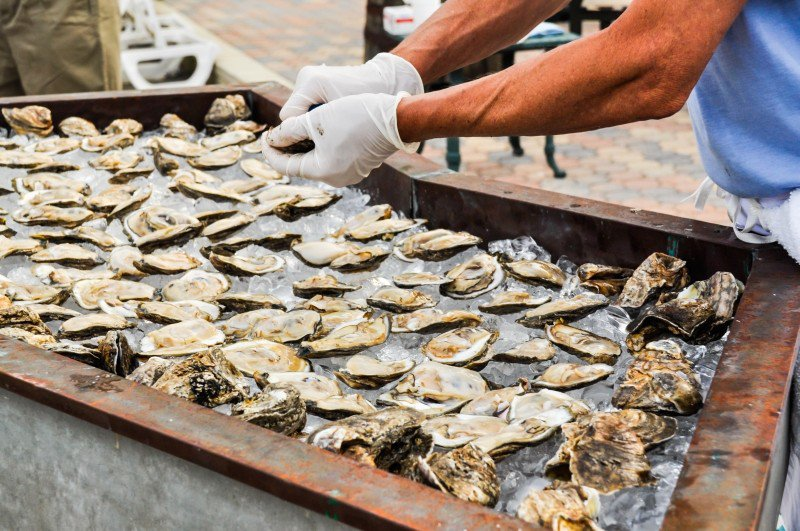 A beachside oyster roast is a Tybee Island Wine Festival tradition and just one of the events that benefits the historic Tybee Post Theater, opening this summer.