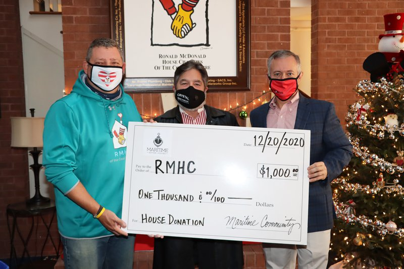 Savannah Maritime After Hours presents a $1,000 check to Ronald McDonald House Charities of the Coastal Empire.