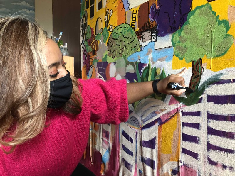 Nae'Keisha Jones works on her Fence Art Project mural in her home studio.
