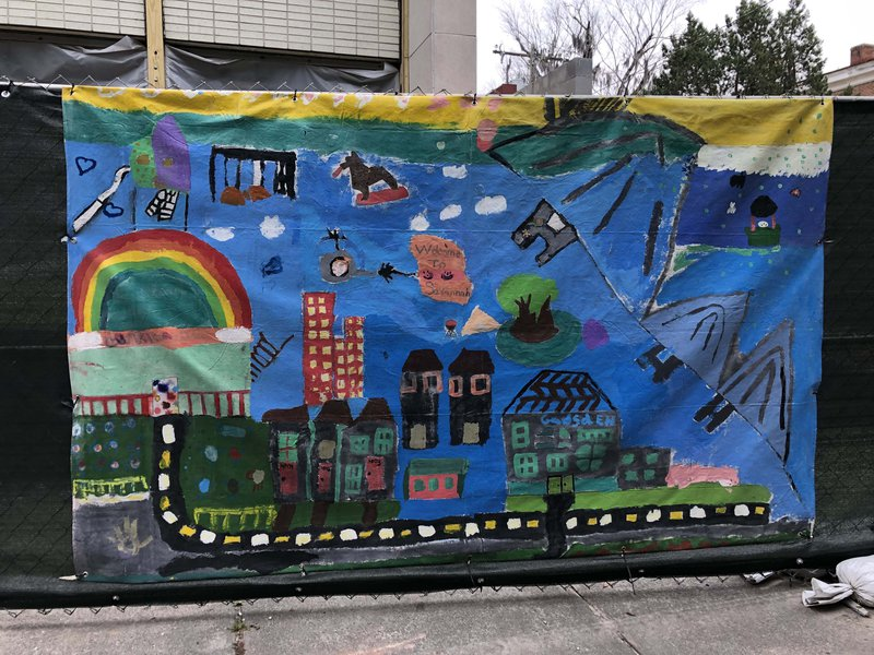 A Fence Art Project mural collaboratively painted by children in the Loop It Up Savannah program.