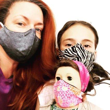 masks-lane_huerta_with_her_daughter_clementine.jpg