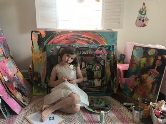 art_beat-zb_with_her_paintings_.jpg
