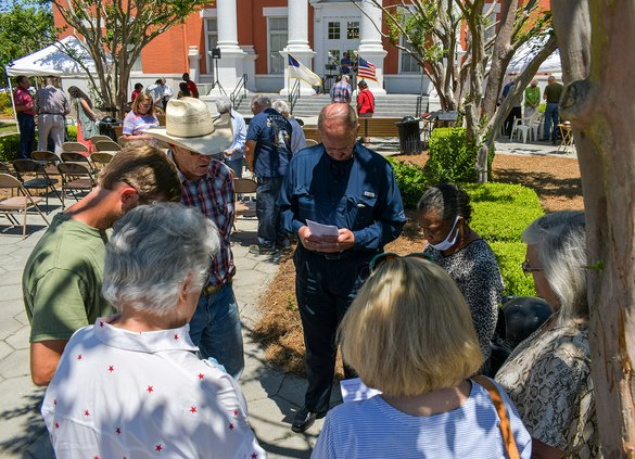 John Emery Brannen, center left, takes his turn leading a prayer circle during the National Day of Prayer observance at the Bulloch County Courthouse on Thursday, May 6.