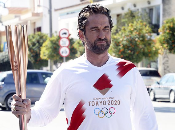 In this photo from March 2020, actor Gerard Butler poses as a torchbearer during the Olympic torch relay of the Tokyo Olympic Games in the southern Greek town of Sparta. Extras are needed for Butler's latest film, which is being shot in Southeast Georgia.