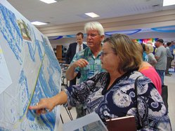 Cindy Culp Hulsey, front right, whose family owns rural land along the proposed path of the S&S Greenway extension, and Ronnie Page, center, a Brooklet resident, look at the plans during Thursday evening's public input meeting at Brooklet Elementary Schoo