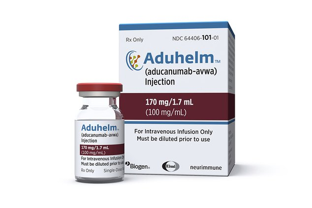 This image provided by Biogen shows a vial and packaging for the drug Aduhelm.
