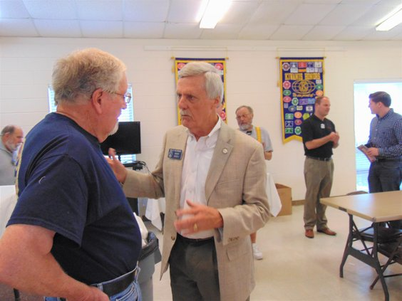 Sen. Billy Hickman, second from left, talks with Statesboro Kiwanis Club member Bill Sellers, left, after the state senator spoke during the club's meeting Thursday.