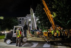 Workers remove a Confederate monument with a crane Thursday, June 18, 2020, in Decatur, Ga. The Sons of Confederate Veterans have sued to return the 30-foot-high obelisk to the site in front of the Georgia courthouse. The monument was taken down last year