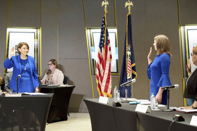 U.S. Sen. Amy Klobuchar, left, D-Minn., swears in witnesses during a Senate Rules Committee field hearing on voting rights at the National Center for Civil and Human Rights in Atlanta, Monday, July 19, 2021.