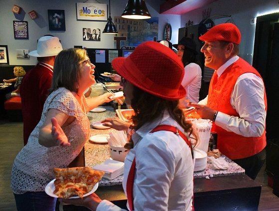 While fresh pizza gets hustled to a table, Chef Joe Tarantino, right, serves up a buffet and a smile to guest Kay Boyd as Tarantino's restaurant opens its doors for the first time last week. Tarantino says he enjoys the relationships he builds through his
