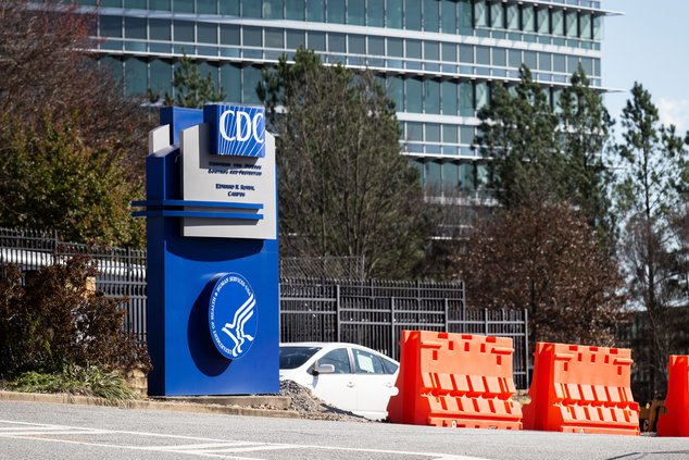 This March 6, 2020, file photo, shows the headquarters for Centers for Disease Control and Prevention in Atlanta. The nation's top health agency is expected to backpedal on its masking guidelines and recommend that even vaccinated people wear masks indoor