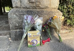 This photo shows a memorial at the Piedmont Park, Wednesday, July 28, 2021 in Atlanta. Authorities are searching for the person who fatally stabbed a woman who was walking her dog in Piedmont Park, one of Atlanta's most popular parks. Katherine Janness, 4