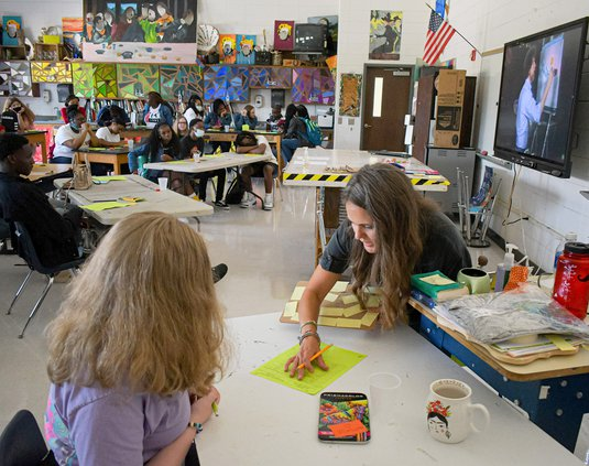 Art teacher Hayley Ward, center, creates a seating chart while trying to inspire her new students with a video featuring Bob Ross as Statesboro High, along with the rest of Bulloch County Schools, welcomes students on the first day of the 2021-22 school y