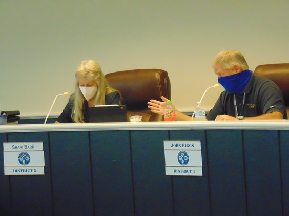 Statesboro City Council members John Riggs, right, and Shari Barr, left, like the other members and the mayor, were wearing masks again Tuesday as COVID-19 concerns received renewed emphasis at City Hall.