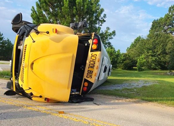 Photo Courtesy Nikki Thompson/Special to the Herald A Bulloch County school bus was struck Thursday morning by a tractor trailer on the U.S. 25 bypass. No children were on the bus at the time.