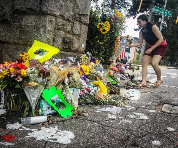 A makeshift memorial to Katherine Janness is seen at the entrance to Piedmont Park on Sunday, Aug. 1, 2021, in Atlanta. Janness, 40, was found stabbed to death in the park in the early hours of July 28.  Police say her dog was also killed at the scene. No