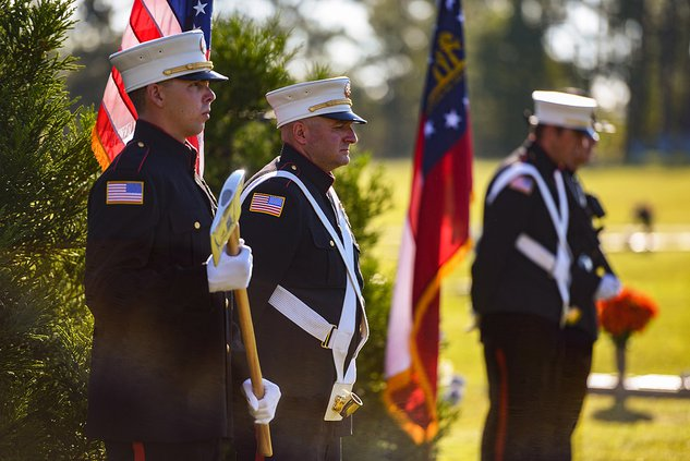 During Bulloch County's 2019 9/11 Memorial Service, Brad Bouchillon, far left, Chris Applebee, center, and Lee Nessmith of the Statesboro Fire Department join Larry Futch of the Statesboro Police Department to form the honor guard for event at Bulloch Mem