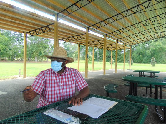 """AL HACKLE/staff Dr. Alvin Jackson, Willow Hill Heritage & Renaissance Center board president, talks about the center's mission and need for support while seated in the new """"COVID-Safe Outdoor Classroom"""" pavilion."""