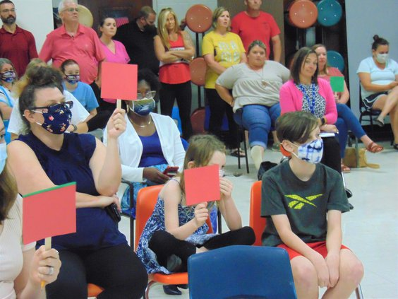Noel Holley, in dark blue mask at left, daughter Addie, center, who is in third grade, and son Joseph, right, a fourth-grader, were three of the speakers for a mask mandate during the Thursday, Sept.  9, Bulloch County Board of Education meeting. Some cit