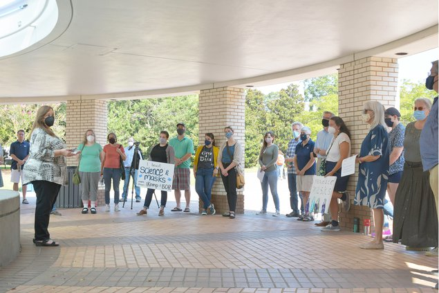 History professor Michelle Haberland, far left, explains why she and other members of Georgia Southern's chapter of the American Association of University Professors joined in statewide protests starting Monday, Sept. 13 asking for mask mandates on Georgi