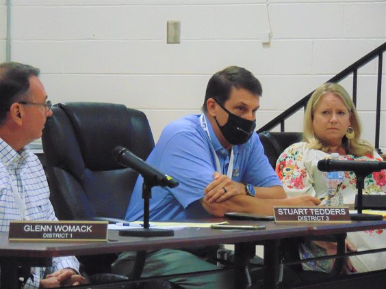 Stuart Tedders, masked in center, Bulloch County Board of Education member representing District 3, speaks as District 1 member Glenn Womack, left, and District 4 member April Newkirk, right, listen during the mask discussion Thursday evening, Sept. 9.