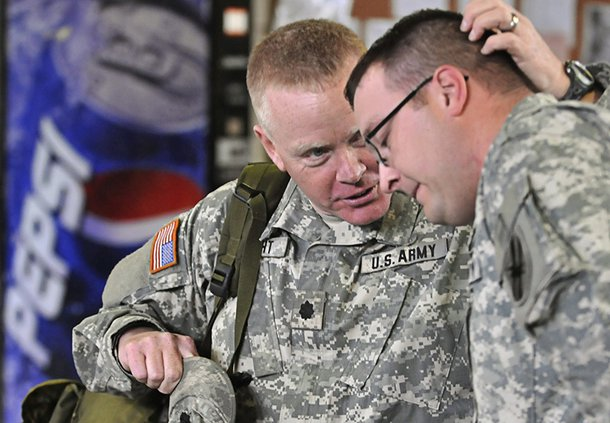 Back in March 2009, Lt. Col. Tom Bright, left, of the Georgia National Guard 48th Brigade Special Troops Battalion, which was stationed at the Statesboro Armory at the time, is shown with Staff Sgt. Kevin Hoffman as the unit was preparing for training and