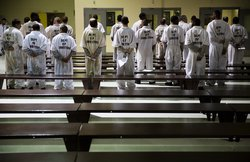 In this Dec. 1, 2015, file photo, prisoners stand while being processed for intake at the Georgia Diagnostic and Classification Prison in Jackson, Ga. The U.S. Department of Justice on Tuesday, Sept. 14, 2021, announced a statewide civil rights investigat