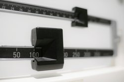 """This Tuesday, April 3, 2018 file photo shows a closeup of a beam scale in New York. A study by the U.S. Centers for Disease Control and Prevention released on Thursday, Sept. 16, 2021, ties the COVID-19 pandemic to an """"alarming"""" increase in obesity in U.S"""