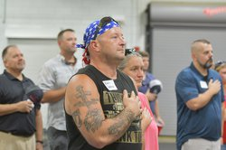Sgt. First Class Kevin Hoffman, who served in Afghanistan with the 48th Brigade Special Troops Battalion, stands at attention for the National Anthem as Georgia Army National Guard veterans from units that deployed to Iraq and Afghanistan out of the State
