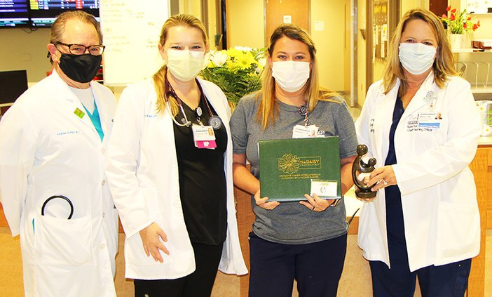 Stephanie Lastinger, LPN, third from left, was awarded the Nurse Leader DAISY Award for Extraordinary Nurses at EGRMC. She is shown with, left to right, Dr. Andrew Cichelli, Tiffany Kreun, Lastinger and Marie Burdett, MSN, RN.