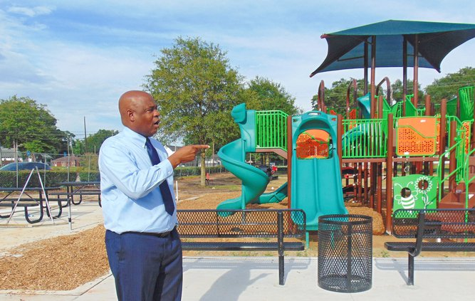 """Mayor Jonathan McCollar, photographed while describing new features of Luetta Moore Park before it reopened July 31, says the $4.5 million park renovations the city of Statesboro undertook this year with the county's cooperation are just one example of """"l"""